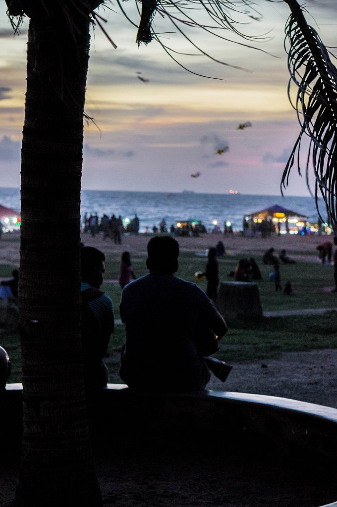 Colombo - Galle Face Green, men sitting, enjoying the biew